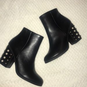 Express brand ankle length black boots.